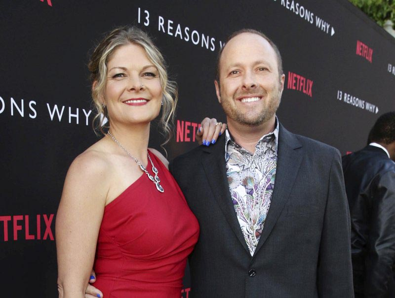 File - Joan Marie and Author Jay Asher appear at the Netflix u009313 Reasons Whyu0094 premiere in Los Angeles, on March 30, 2017. Photo: AP