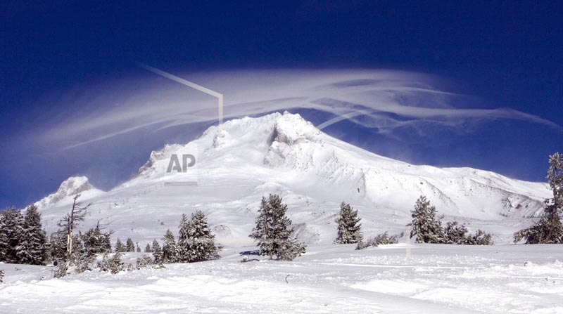 FILE - In this December 13, 2009, file photo, a cloud forms over Mount Hood as seen from Government Camp, Ore. Authorities say a rescue effort is underway, Tuesday, Feb. 13, 2018, for a climber who fell on Mount Hood. Photo: AP