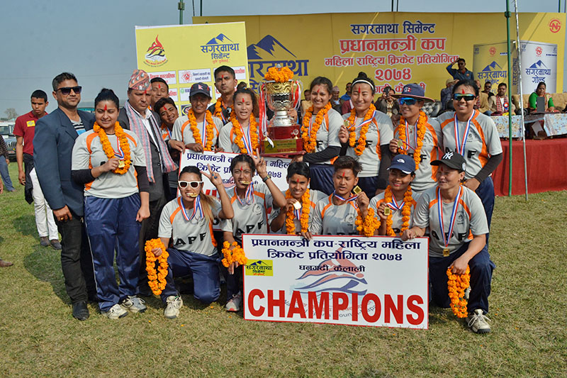Champion APF along with their officials pose for a portrait after winning the PM Cup Women's Cricket Tournament in Dhangadhi, on Sunday, February 25, 2018. Photo: Tekendra Deuba