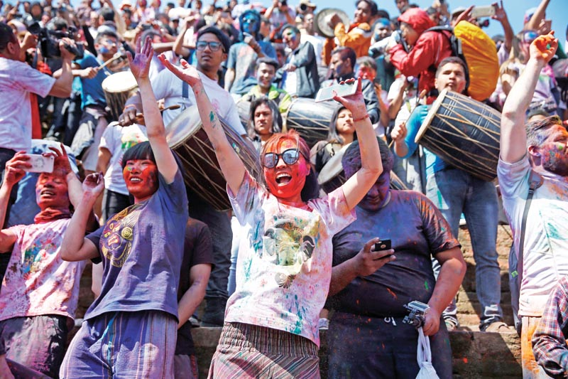 Revelers take part in celebrations of the Holi festival, known as the carnival of colors in Kathmandu, Nepal on Sunday, March 12, 2017.