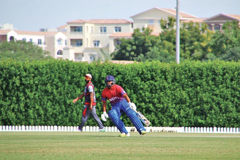 Nepalu2019s Gyanendra Malla runs between the wickets during their second practice match against the UAE at the ICC Oval Cricket Ground in Dubai on Wednesday. Photo Courtesy: Raman Shiwakoti