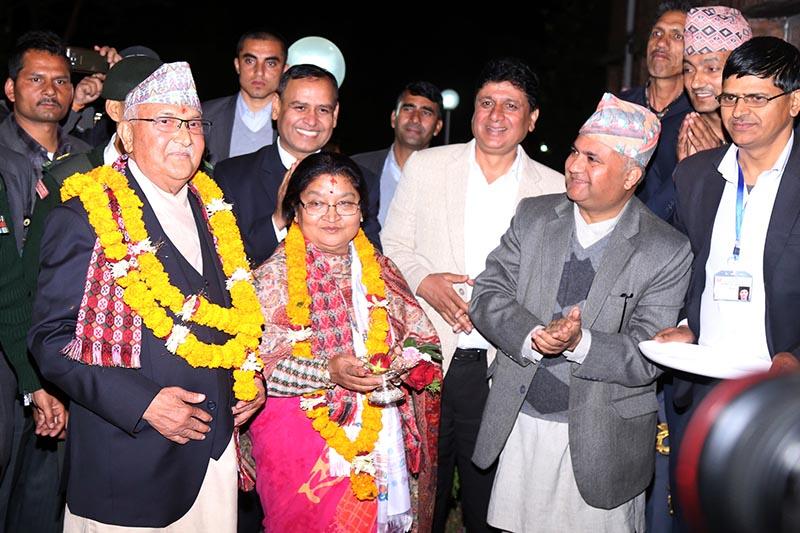Prime Minister KP Sharma Oli along with Rashika Shakya enters PM's official residence in Baluwatar, Kathmandu, on Sunday, February 18, 2018. Photo: RSS