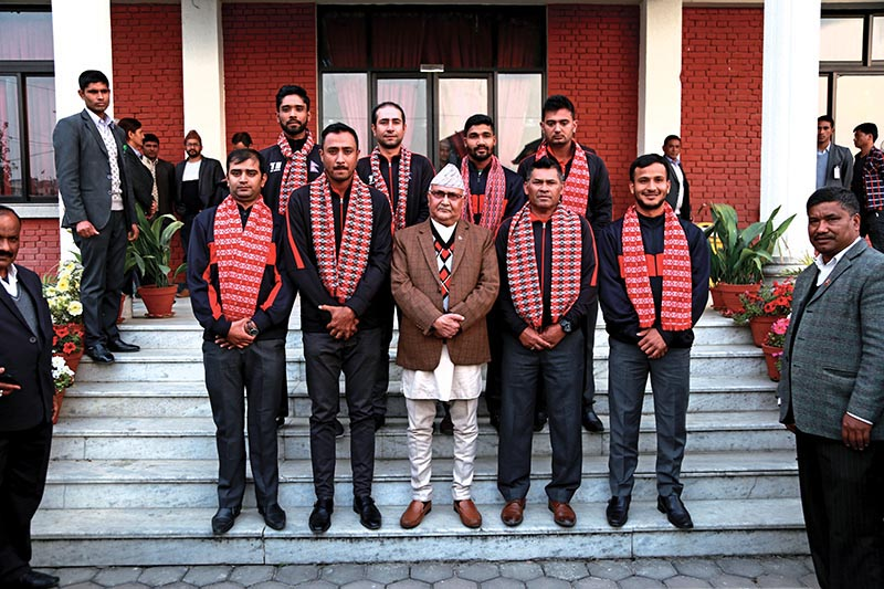 Nepal national cricket team members with Prime Minister KP Sharma Oli in Baluwatar on Monday. Photo: THT
