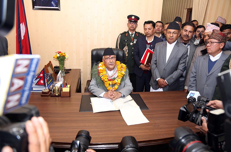Newly appointed Prime Minister KP Sharma Oli endorses a proposal to formulate the good conduct policy after assuming the office, in Singhadarbar, Kathmandu, on Thursday, February 15, 2018. Photo: RSS