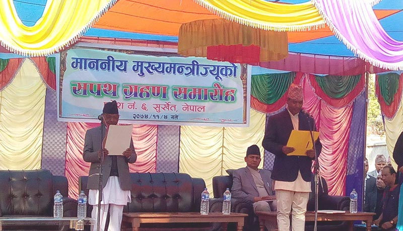 (Left) Provincial Governor Durga Keshar Khanal administering the oath of office and secrecy to newly nappointed Province 6 Chief Minister Mahendra Bahadur Shahi, in Birendranagar, on Friday, February 16, 2018. Photo: THT