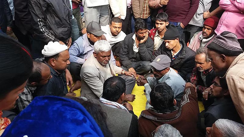 Local shopkeepers holding discussion after Rajbiraj Municipal Office issued a notice asking them to remove shops from Hatiya area of the municipality, in Saptari, on Sunday, February 4, 2018. Photo: THT