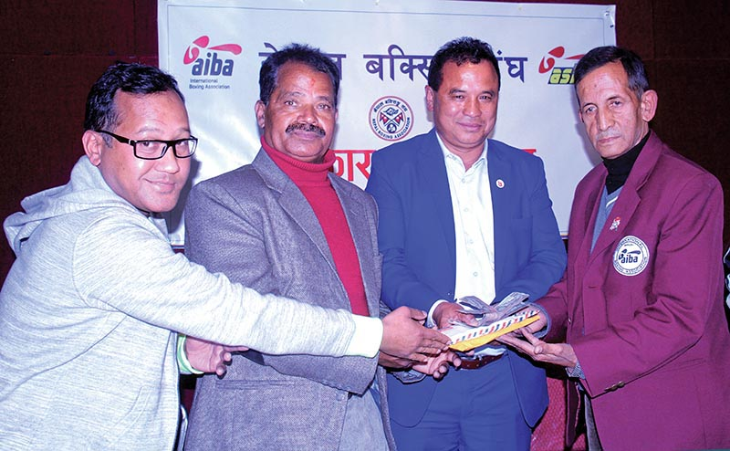 Referee Manju Jung Thapa (right) receiving financial assistance at a programme in Kathmandu on Sunday.