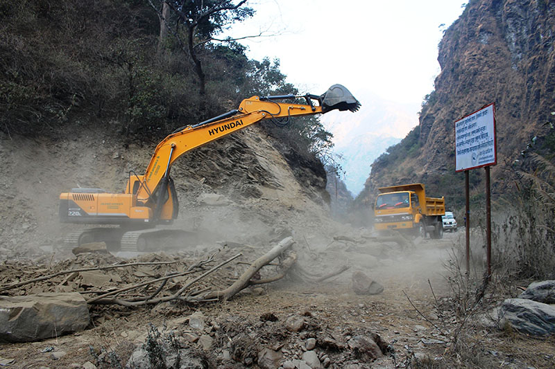 An excavator being used for the construction of Beni-Jomsom-Korala road section at Raghuganga Rural Municipality-2 in Myagdi district, on Tuesday, February 06, 2018. Photo: RSS