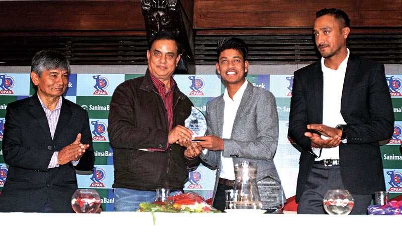 Senior artists Madan Krishna Shrestha and Hari Bansha Acharya felicitating cricketer Sandeep Lamichhane at a programme of Sanima Bank on Thursday. Photo: Udipt Singh Chhetry/ THT