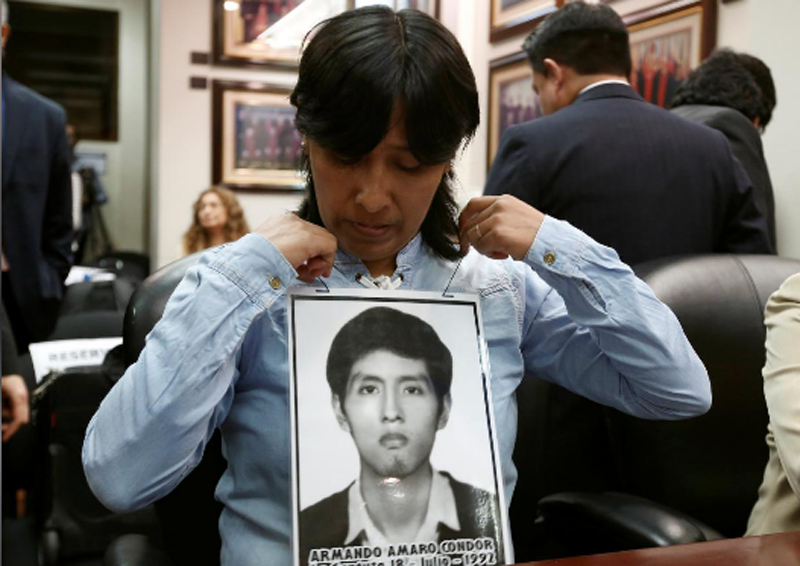 Carmen Condor, hangs a portrait of her brother Amaro Condor, victim of repression amid the ruling of Alberto Fujimori, before a hearing convened by the judges of the Inter-American Court of Human Rights in San Jose, Costa Rica, February 2, 2018. Photo: Reuters.n