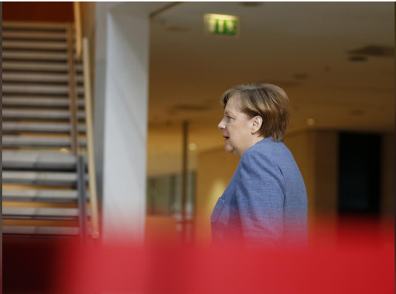 German Chancellor Angela Merkel of the Christian Democratic Union (CDU) arrives for coalition talks at the Social Democratic Party (SPD) headquarters in Berlin, Germany, February 4, 2018. Photo: Reuters.