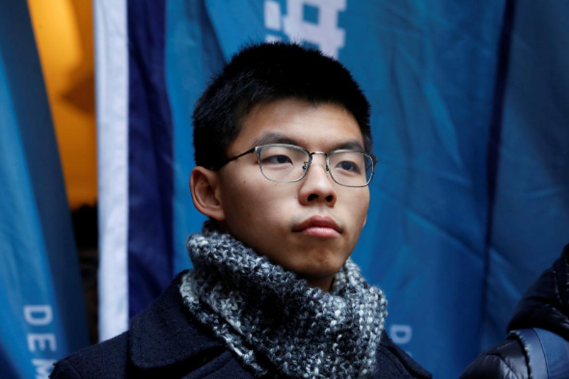 Pro-democracy activist Joshua Wong poses outside the Court of Final Appeal before a verdict on his appeal in Hong Kong, China February 6, 2018. Photo: Reuters
