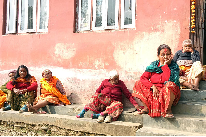 Senior citizens basking in the sun on the premises of state-run oldage home at Devghat in Chitwan, on Friday, February 02, 2018. Photo: RSS