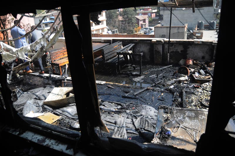 Wreckage at the Share Market building after fire erupted in Putalisadak, Kathmandu, on Monday, February 27, 2018. Photo: THT