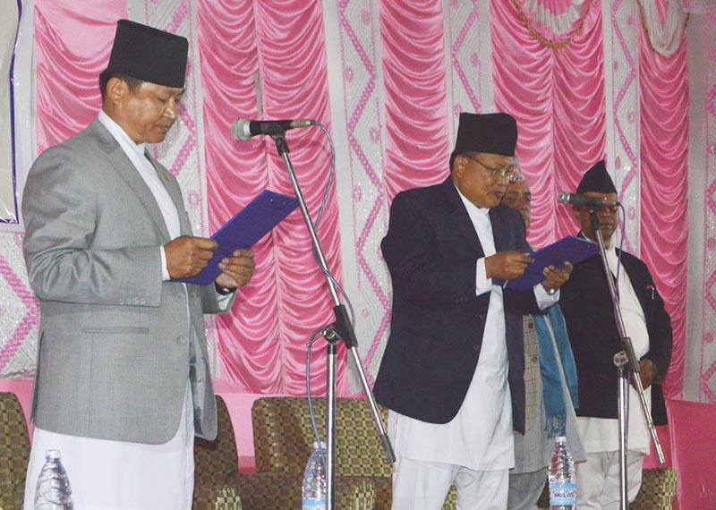 Province 1 Governor Govinda Tumbahang administering oath of office and secrecy to Chief Minister Sherdhan Rai in Biratnagar, Morang, on Thursday, February 15, 2018. Photo: THT