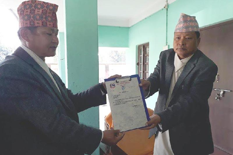 Governor Govinda Tumbahang handing over a certificate to Province 1 Chief Minister Sherdhan Rai (left) in the governoru2019s office, Biratnagar, on Wednesday, February 14, 2018. Photo: THT