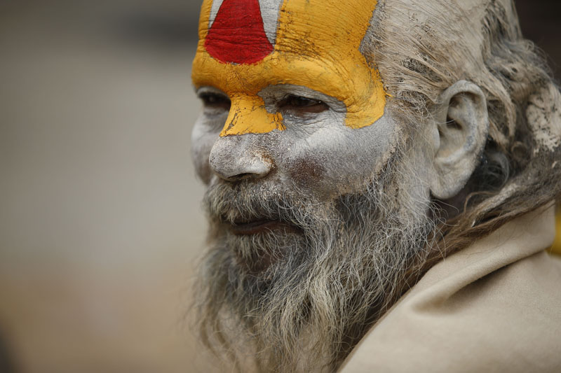 A Sadhu who is considered holy rests near his ashram on the eve of Mahashivaratri festival inside Pashupatinath Temple in Kathmandu, on Monday, February 12, 2018. Thousands of sadhus from Nepal and India celebrate the festival of Mahashivaratri by smoking marijuana, smearing their bodies with ash and offering prayers to the Hindu Deity Lord Shiva. Photo: Skanda Gautam