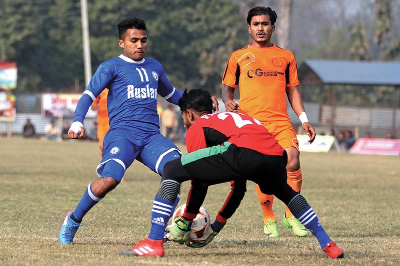 Players of Three Star (left) and Farwest Sports Club vie for the ball during their ninth Ruslan Simara Gold Cup match in Bara. Photo: THT