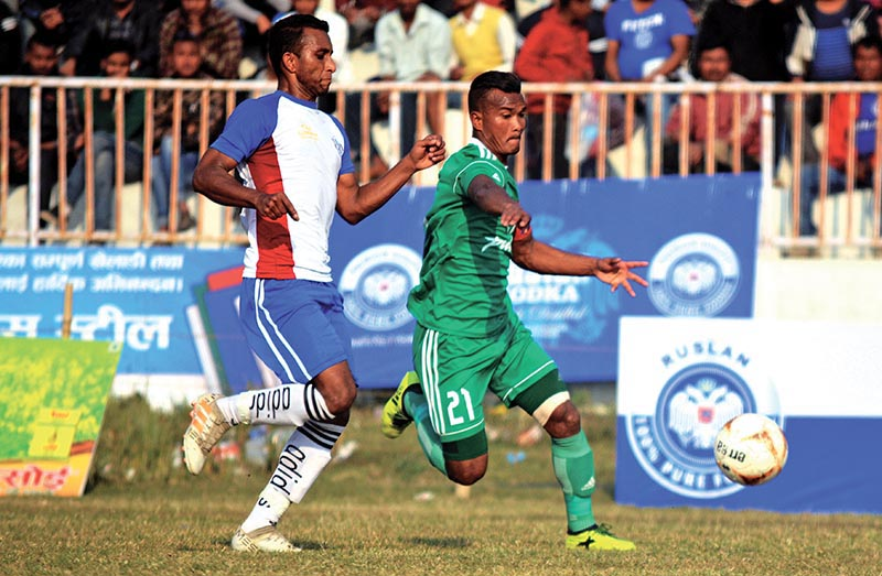 TACu2019s Bharat Khawas (right) dribbles the ball past Birgunj United player during their Ruslan ninth Simara Gold Cup match in Bara on Thursday. TAC won the match 3-0. Photo: THT