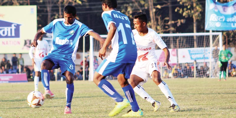 Action in the match between NJYC Blue and Nepal APF Club (right) during the Ruslan ninth Simara Gold Cup in Bara on Friday, February 9, 2018. Photo: THT