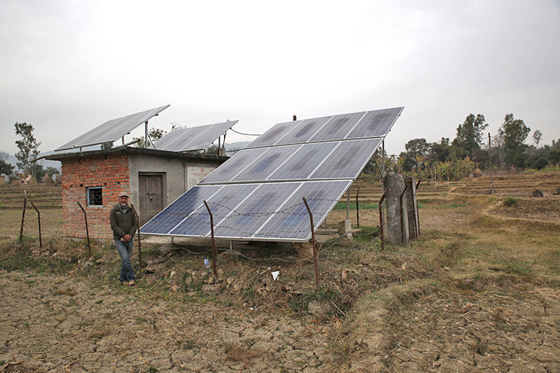 A solar panel installed in October 2017 powers a pump bringing up 40,000 litres of water per day to the remote village of Shikharpur in Nepal, 7 February 2018. Photo: Reuters