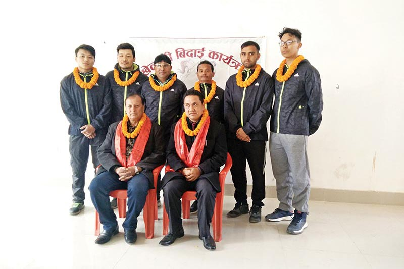 Nepali taekwondo team members pose for a group photo with officials at a farewell programme in Lalitpur on Thursday. Photo: THT