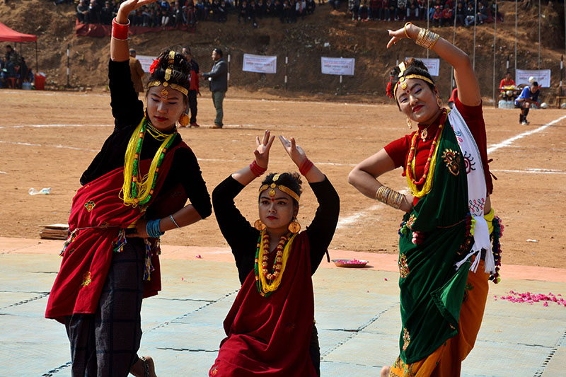 Local artists clad in traditional attires performing dance in Baglung district, on Friday, February 02, 2018. Photo: RSS
