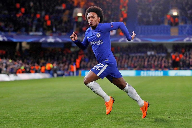 Chelsea's Willian celebrates scoring their first goal. Photo: Reuters