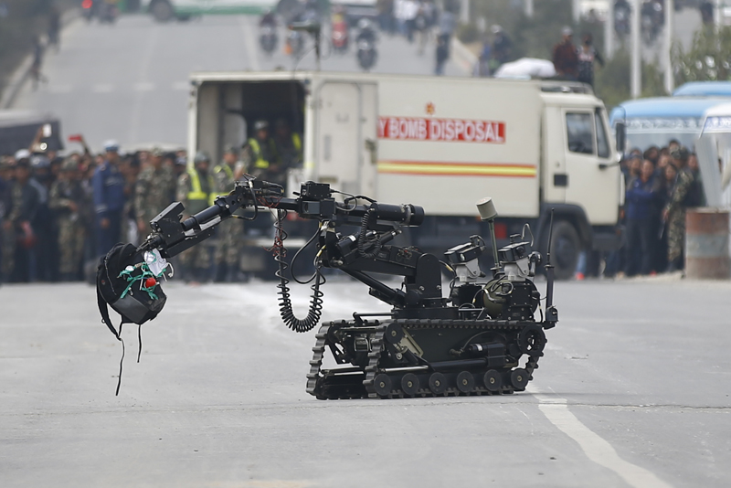 A machine of the Nepal Army bomb disposal squad carries the bag containing the bomb found in front of the Metropolitan Police Circle in Kathmandu, on Tuesday, February 20, 2018. Photo: Skanda Gautam