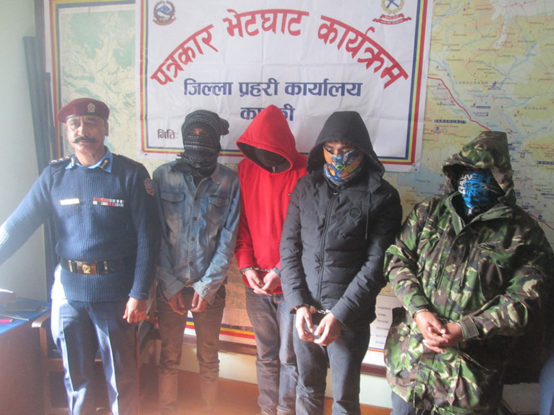 Kaski Police making public a gang of four persons who were arrested on charge of extortion, in Pokhara, Kaski, on Thursday, February 1, 2018. Photo: Rishi Ram Baral