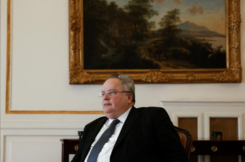 FILE-Greek Foreign Minister Nikos Kotzias speaks during an interview with Reuters at the Foreign Ministry in Athens, Greece, January 31, 2018. Photo: Reuters.