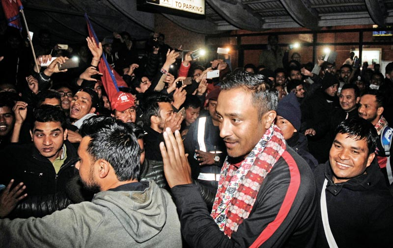 Nepal national cricket team skipper Paras Khadka acknowledges the crowd upon arrival at the TIA in Kathmandu on Saturday, February 17, 2018. Photo: THT