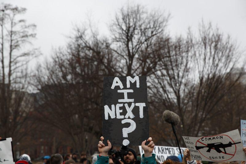 Demonstrators hold signs during a protest in favor of gun control reform in front of the White House, on Monday, Feb. 19, 2018, in Washington. Photo: AP