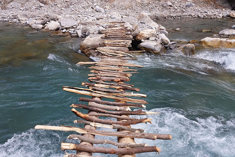 A wooden makeshift bridge constructed by Indian side over Mahakali river in Kanchanpur district, on Wednesday, February 28, 2018. It has been learned that the bridge was constructed without Nepal's concent. Photo: RSS