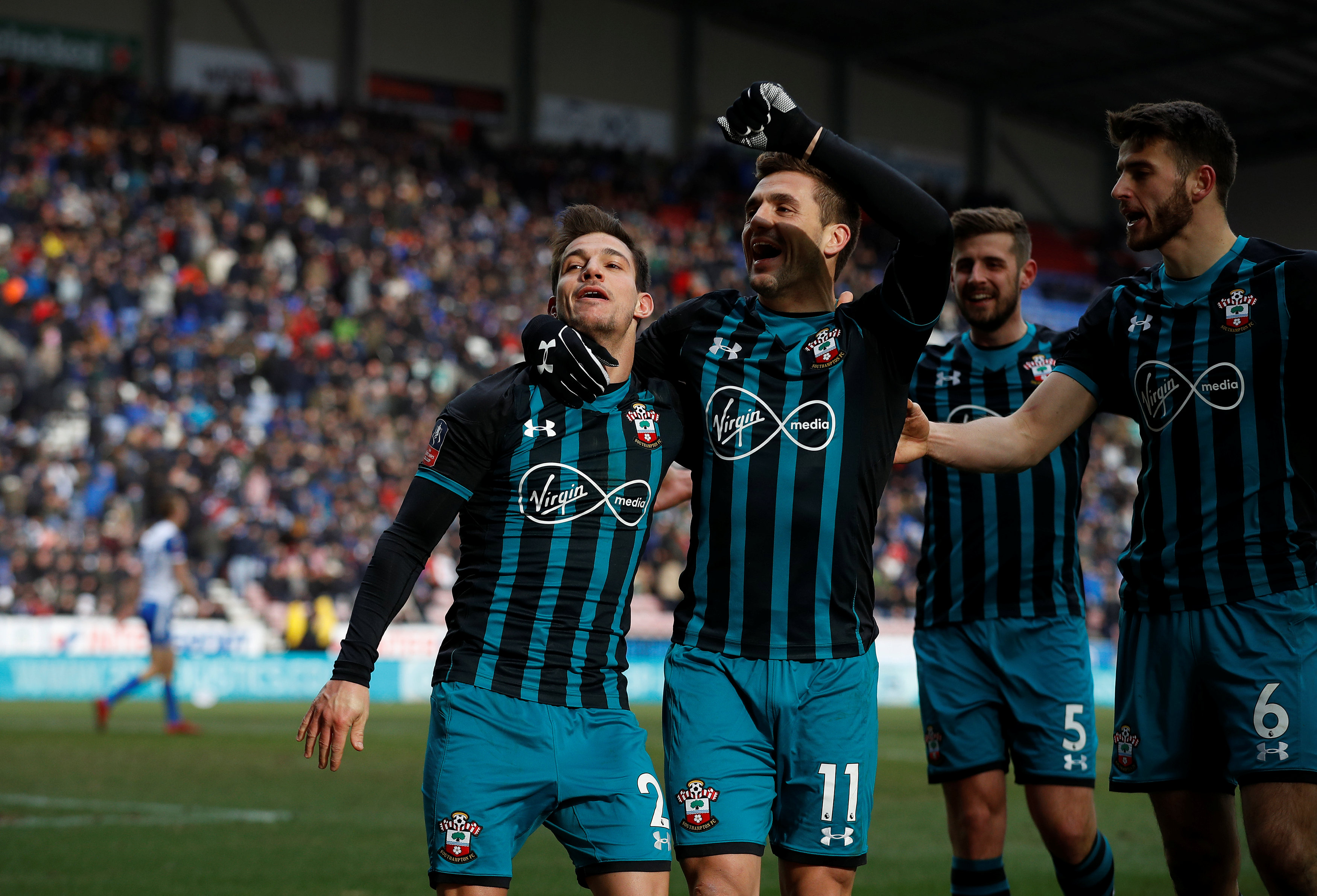 Soccer Football - FA Cup Quarter Final - Wigan Athletic vs Southampton - DW Stadium, Wigan, Britain - March 18, 2018   Southampton's Cedric Soares celebrates scoring their second goal with Dusan Tadic and teammates   REUTERS/Phil Noble