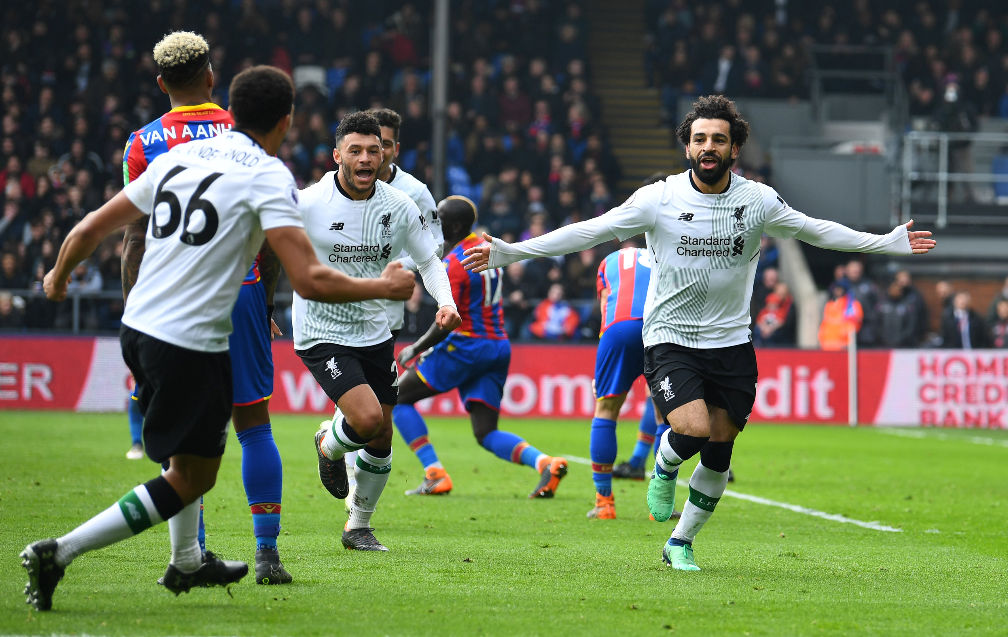Soccer Football - Premier League - Crystal Palace vs Liverpool - Selhurst Park, London, Britain - March 31, 2018   Liverpool's Mohamed Salah celebrates scoring their second goal with Alex Oxlade-Chamberlain and Trent Alexander-Arnold    REUTERS