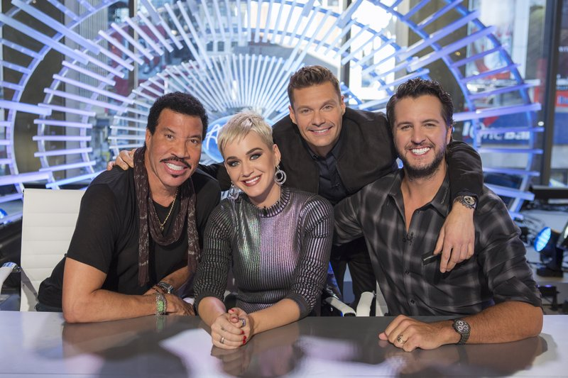 ABC shows, from left, Lionel Richie, Katy Perry, Ryan Seacrest and Luke Bryan in New York. Richie, Perry and Bryan are the judges on the next season of u201cAmerican Idol,u201d premiering March 11 on ABC. Photo: AP