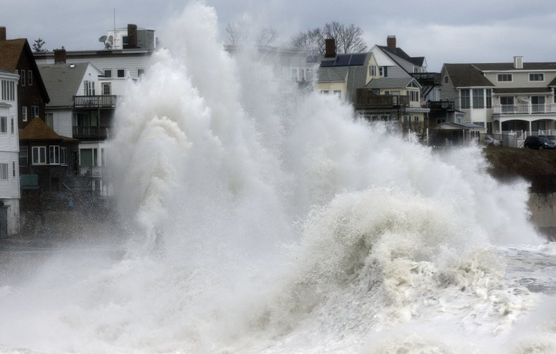 A large wave crashes into a seawall in Winthrop, Mass, Saturday, March 3, 2018. Photo: AP