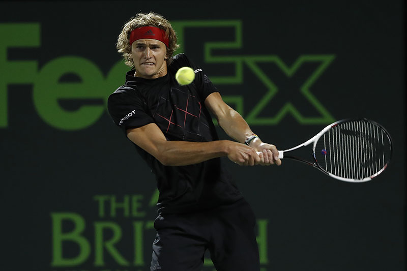 Mar 27, 2018; Key Biscayne, FL, USA; Alexander Zverev of Germany hits a backhand against Nick Kyrgios of Australia (not pictured) on day eight of the Miami Open at Tennis Center at Crandon Park. Zverev won 6-4, 6-4. Mandatory Credit: Geoff Burke-USA TODAY Sports