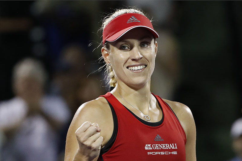Mar 24, 2018; Key Biscayne, FL, USA; Angelique Kerber of Germany waves to the crowd after her match against Anastasia Pavlyuchenkova of Russia (not pictured) on day five of the Miami Open at Tennis Center at Crandon Park. Kerber won 6-4, 6-4. Mandatory Credit: Geoff Burke-USA TODAY Sports