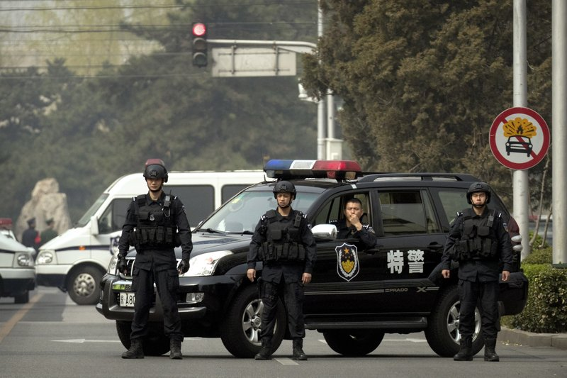 File - Police in tactical gear block a road leading to the Diaoyutai State Guesthouse in Beijing, Tuesday, on March 27, 2018. Photo: AP
