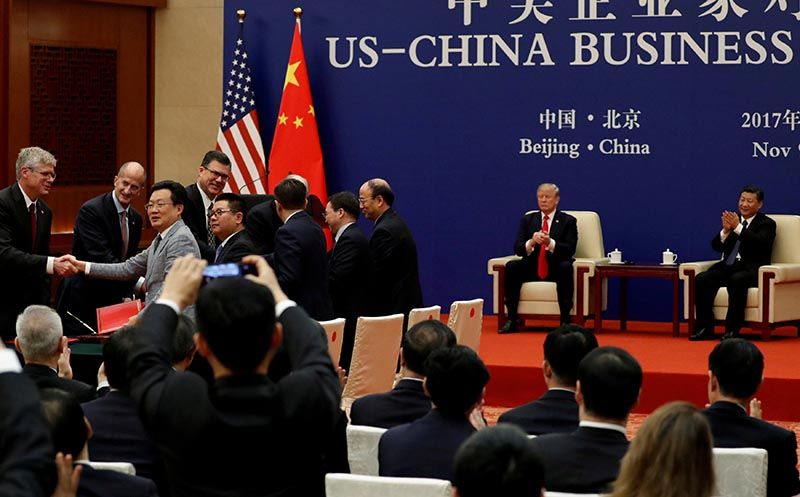 China's President Xi Jinping and US President Donald Trump witness US and Chinese business leaders signing trade deals at the Great Hall of the People in Beijing, China, on November 9, 2017. Photo: Reuters/ File
