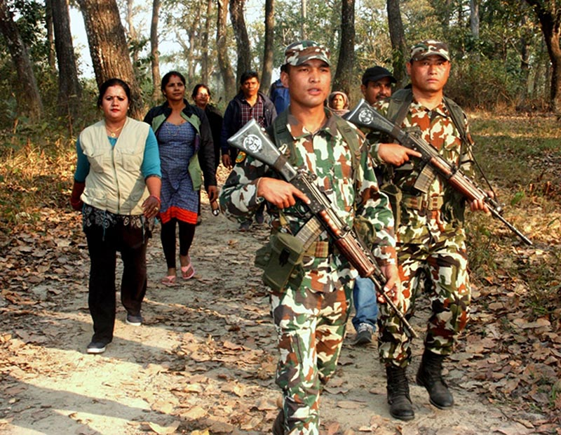A joint team of local community members and Nepal Army personnel patrolling at khorsor in the vicinity of the Chitwan National Park on Thursday, March 22, 2018. Photo: RSS