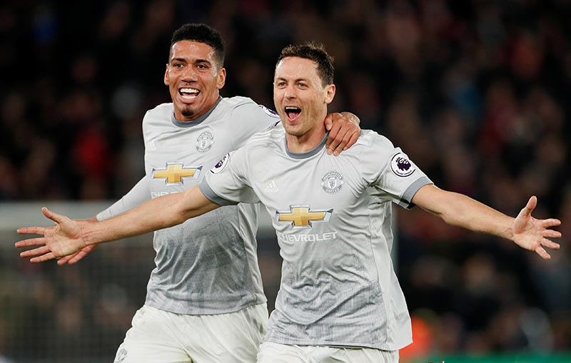 Manchester United's Nemanja Matic celebrates scoring their third goal with Chris Smalling during the Premier League match between Crystal Palace and Manchester United, at Selhurst Park,  in London, Britain, on March 5, 2018. Photo: Reuters