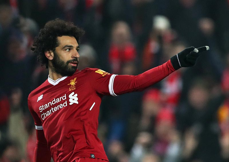 Liverpool's Mohamed Salah celebrates scoring their first goal during the premier League match between Liverpool and Newcastle United, at Anfield, Liverpool, Britain, on March 3, 2018. Photo: Reuters