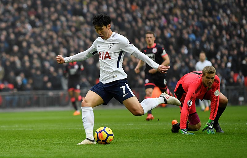 Tottenham's Son Heung-min scores their first goal during the Premier League match between Tottenham Hotspur and Huddersfield Town, at Wembley Stadium, in London, Britain, on March 3, 2018. Photo: Action Images via Reuters