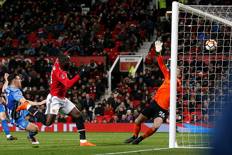 Manchester United's Romelu Lukaku scores their first goal during the FA Cup quarter-final match between Manchester United and Brighton and Hove Albion, at Old Trafford, in Manchester, Britain, on March 17, 2018. Photo: Reuters