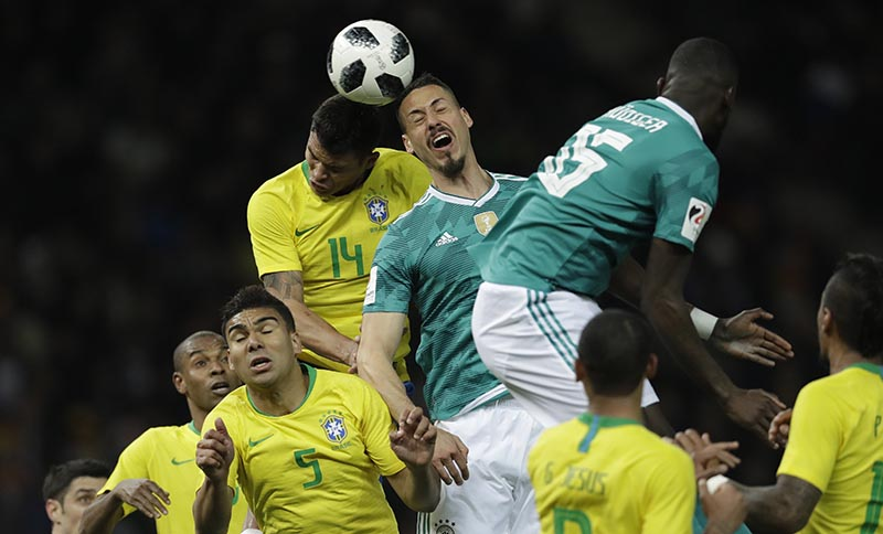 Germany's Sandro Wagner, center, is airborne with Brazil's Thiago Silva during the international friendly soccer match between Germany and Brazil in Berlin, Germany, on Tuesday, March 27, 2018. Photo: AP