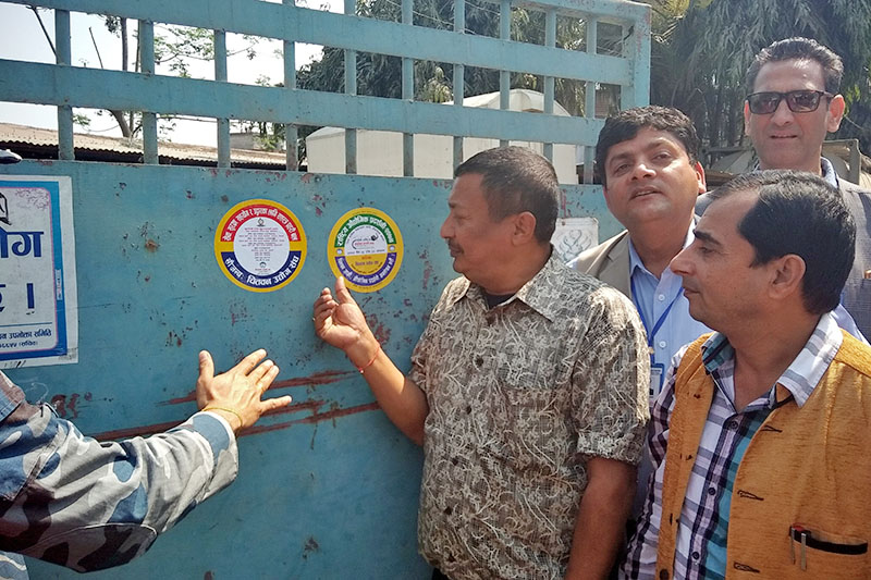 Local traders in coordiantion with APF and local representatives launch industrial security sticker campaign in Chitwan, on Friday, March 09, 2018. Photo: Tilak Rimal