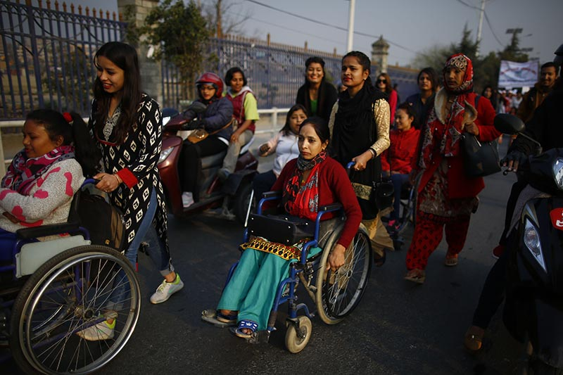 Women with disabilities using wheelchairs, participate in a rally held to mark the 108th International Women's Day organised by the Ministry of Women, Children and Social Welfare in Kathmandu, on Thursday, March 8, 2018. Photo: Skanda Gautam/THT